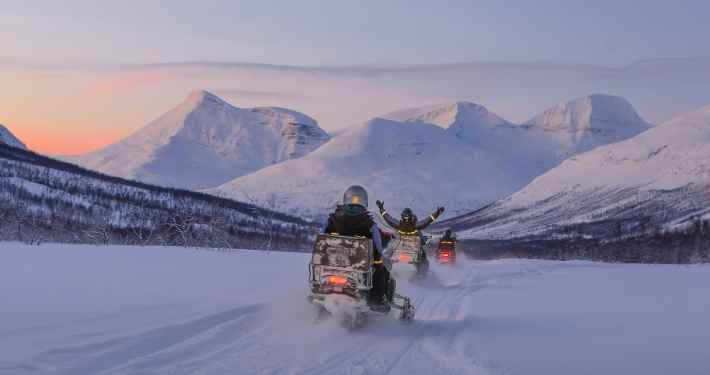 From Tromso: Full-day Snowmobiling, Ice-Fishing and Dog Sledding Tour Experience