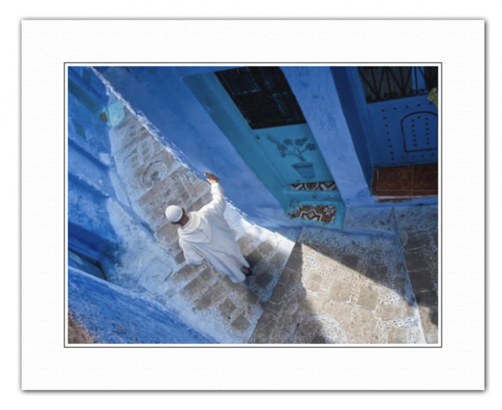 A man resting on the stairs - Chefchaouen