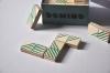 Jeu de domino sur Bois motifs lignes coloris émeraude